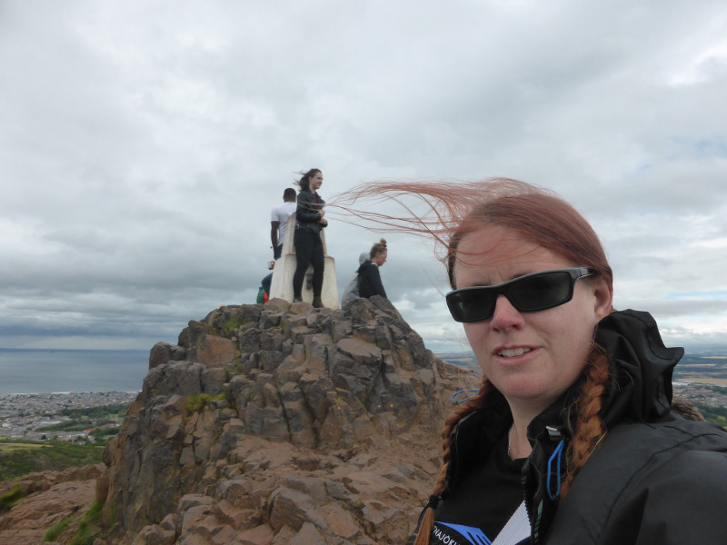 At the summit of Arthur's Seat in the wind