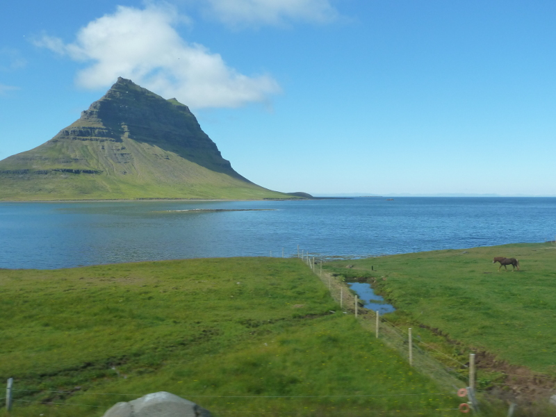 The iconic Kirkjufell from a moving coach