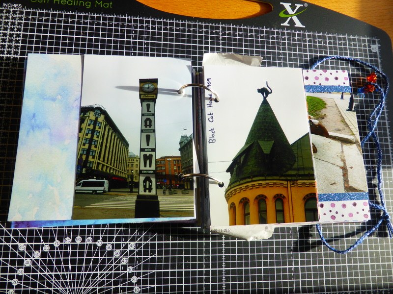Photo pages in travel scrapbook